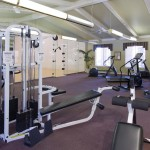 Fitness center with weight machines, cardio machines, and an indoor racquetball court.