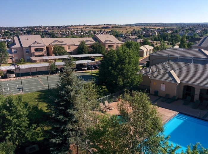View from ridge looking out over basketball court and pool at Pine Bluffs